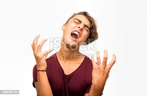 istock Portrait of furious young man screaming over white background 598055154