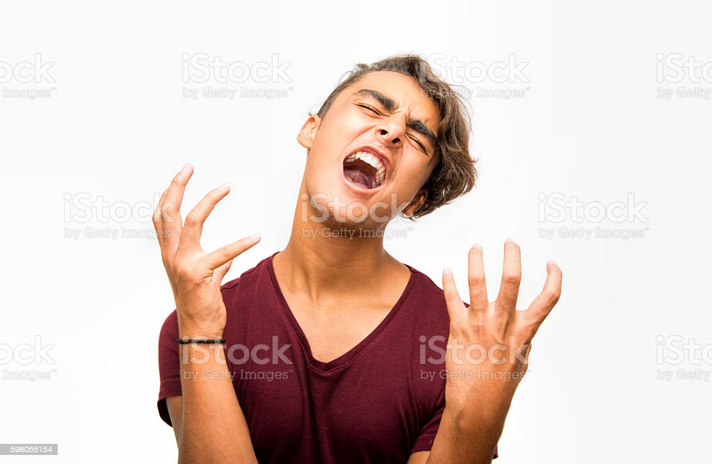 Portrait of furious young man screaming over white background stock photo
