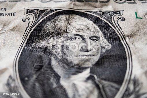 Portrait of George Washington on a mint 1 dollar bill close-up