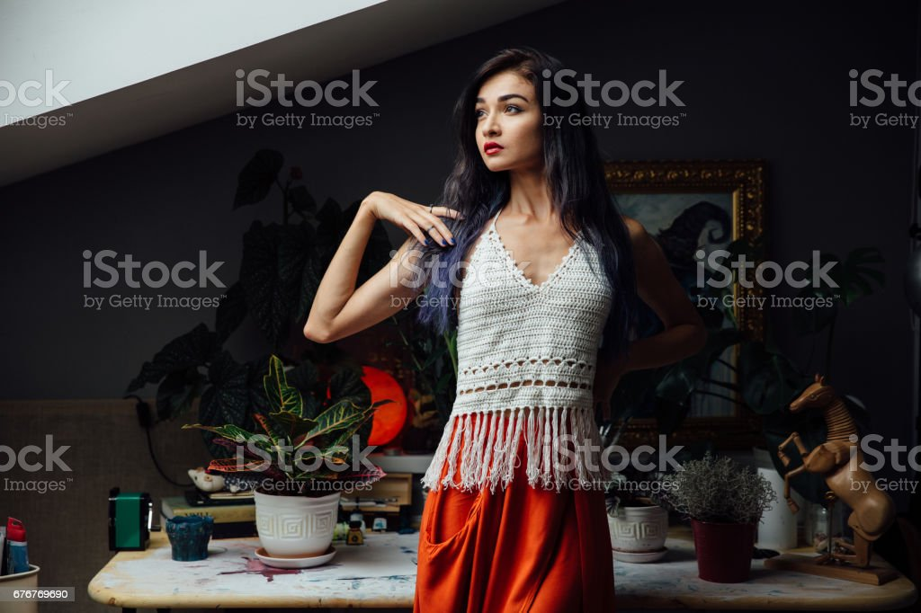 portrait of girl close-up lifestyle ,wearing trendy knitted wool bohemian style, ,hippie chic ,gypsy fashion stock photo