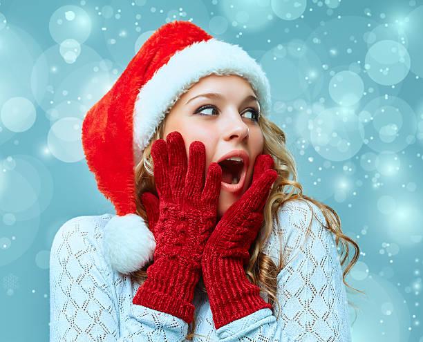portrait of girl dressed in santa hat stock photo