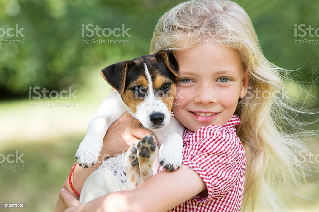 Portrait Of Girl Holding Pet Dog stock photo