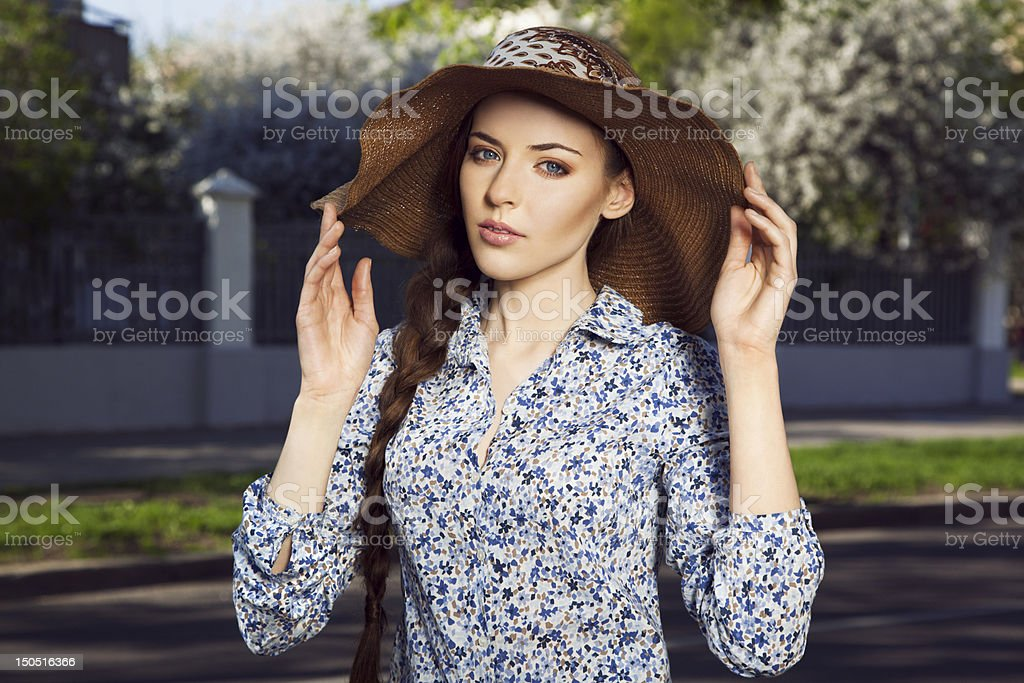 Portrait of girl in the hat stock photo