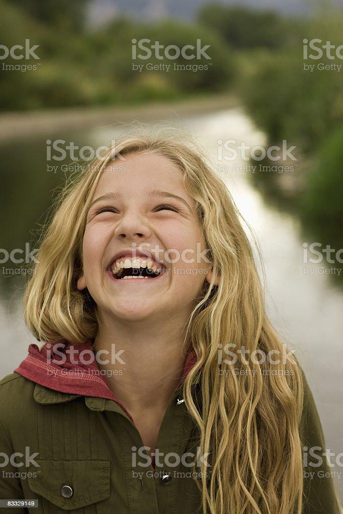 Portrait of girl laughing outside royaltyfri bildbanksbilder
