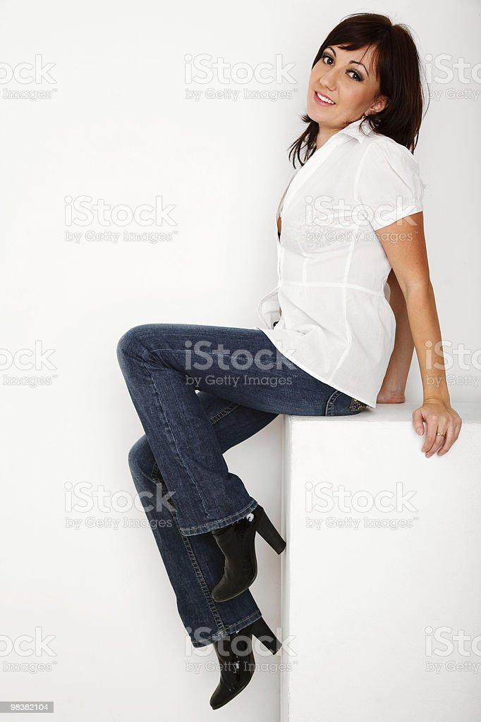 Portrait of girl sitting in white studio royalty-free stock photo