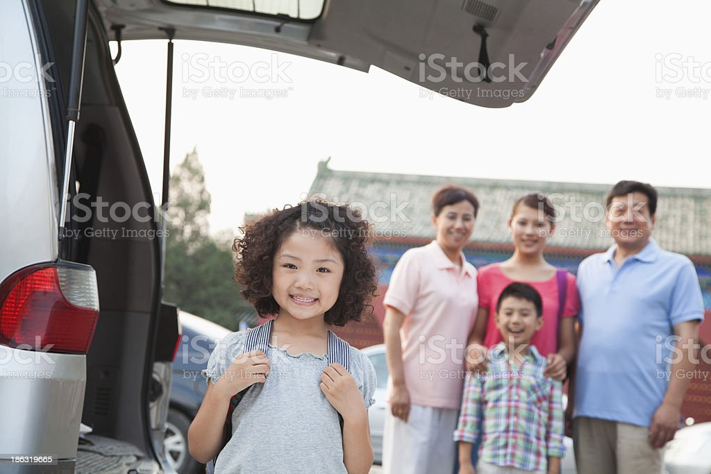 Portrait of girl with her family in the background royalty-free stock photo