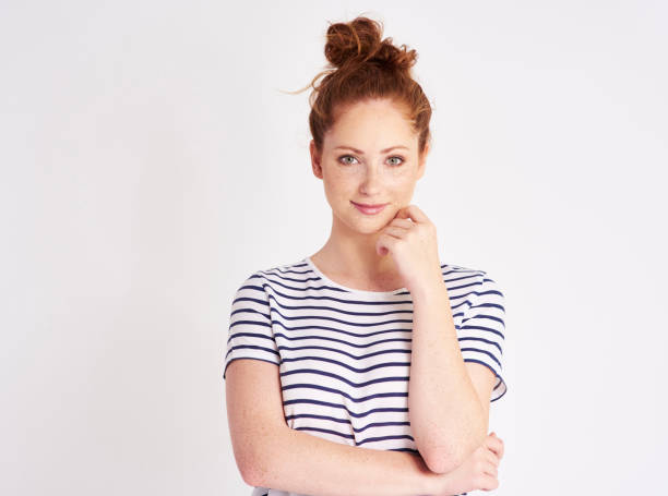 Portrait of girl with red hair and freckles at studio stock photo