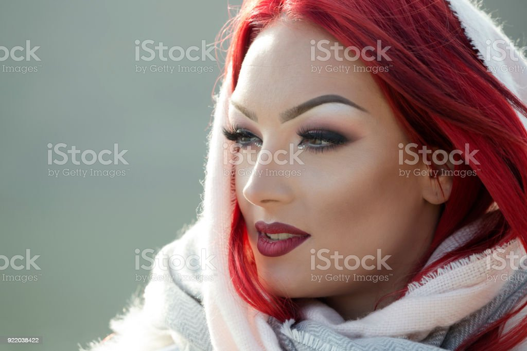 f94bfefd1c130 Portrait of glamorous redhead beautiful woman wearing scarf wrapped around  her head royalty-free stock