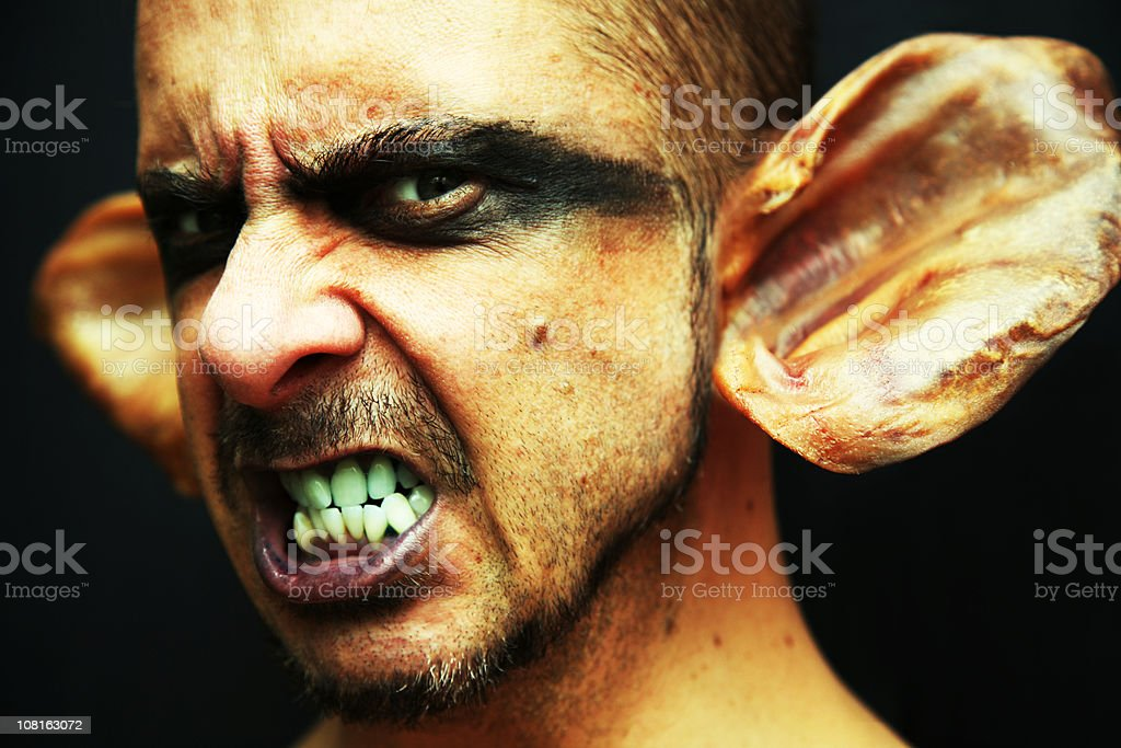 Portrait of Goblin Man with Pigs Ears stock photo