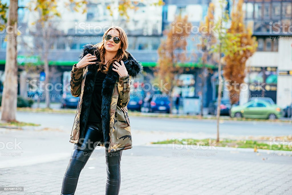 Portrait of good-looking young woman in downtown in autumn – Foto