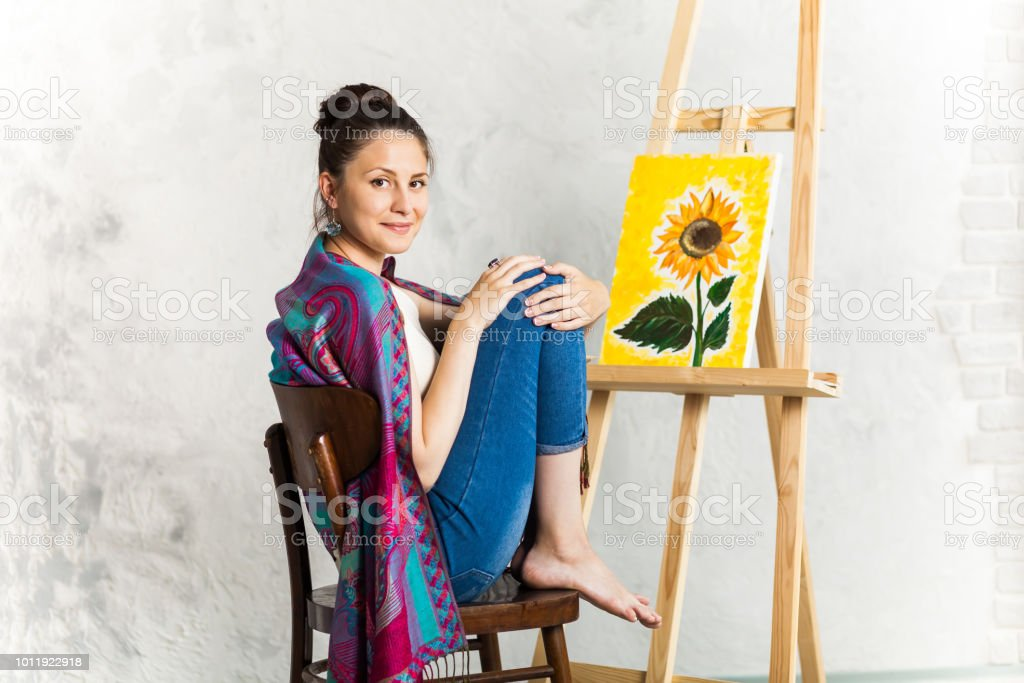 Portrait Of Gorgeous Woman Artist Painting At Home Stock