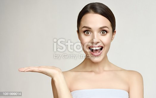 1070715740 istock photo Portrait of gorgeous, young laughing woman. Hype. 1051999014