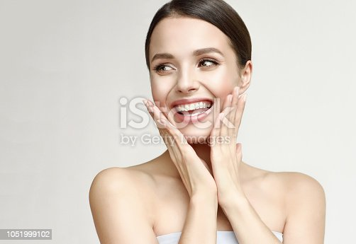 istock Portrait of gorgeous, young laughing woman. Joy and happiness. 1051999102