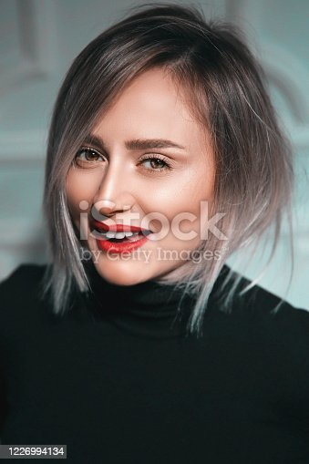 1051999102 istock photo Portrait of gorgeous, young laughing woman. Joy and happiness 1226994134