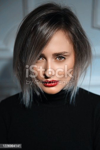 1051999102 istock photo Portrait of gorgeous, young laughing woman. Joy and happiness 1226994141