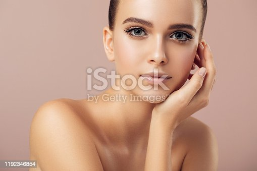 1070715740 istock photo Portrait of gorgeous young woman 1192346854