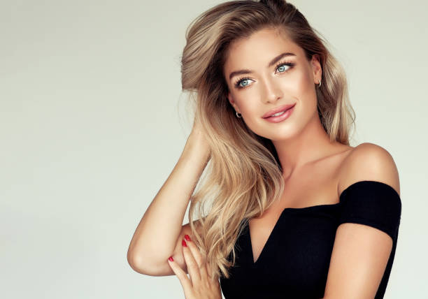 portrait of gorgeous young woman with elegant make up and perfect golden hairstyle. - beautiful people stock pictures, royalty-free photos & images