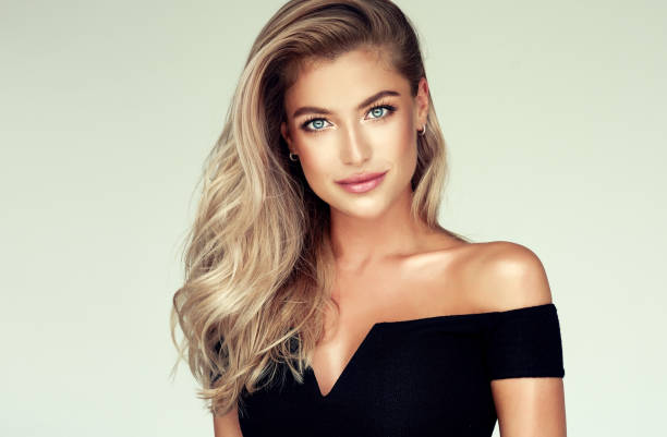 Portrait of gorgeous young woman with elegant make up and perfect golden hairstyle. stock photo