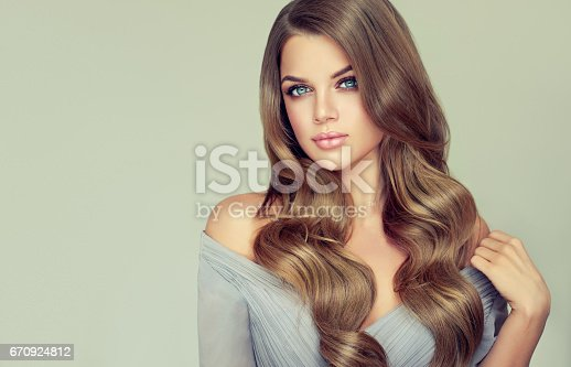 697916070istockphoto Portrait of gorgeous young woman with elegant make up and perfect hairstyle. 670924812