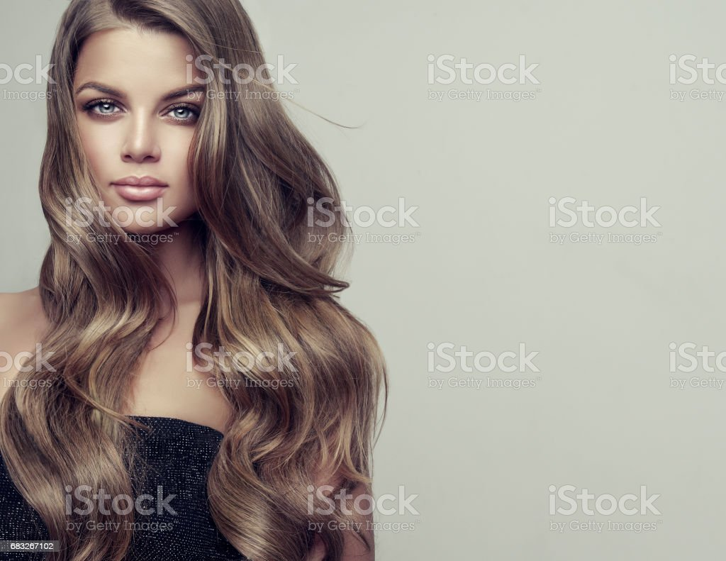 Portrait of gorgeous young woman with elegant make up and perfect hairstyle. stock photo