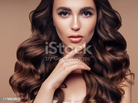 Portrait of gorgeous young woman with elegant make-up and perfect hairstyle