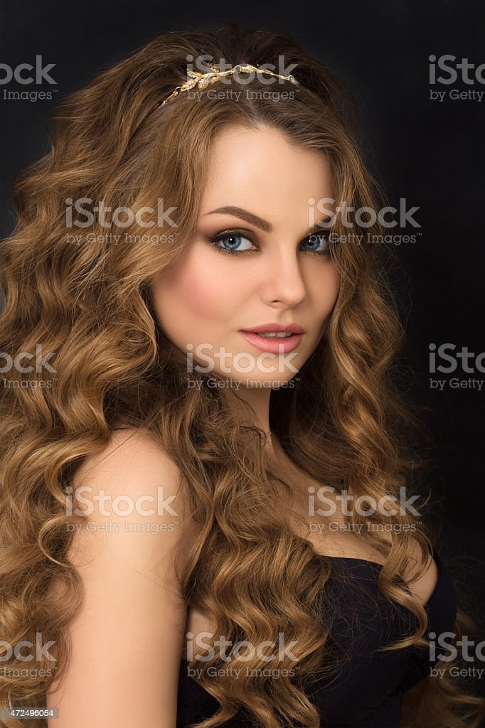 Portrait of gorgeous young woman with long curly hair stock photo