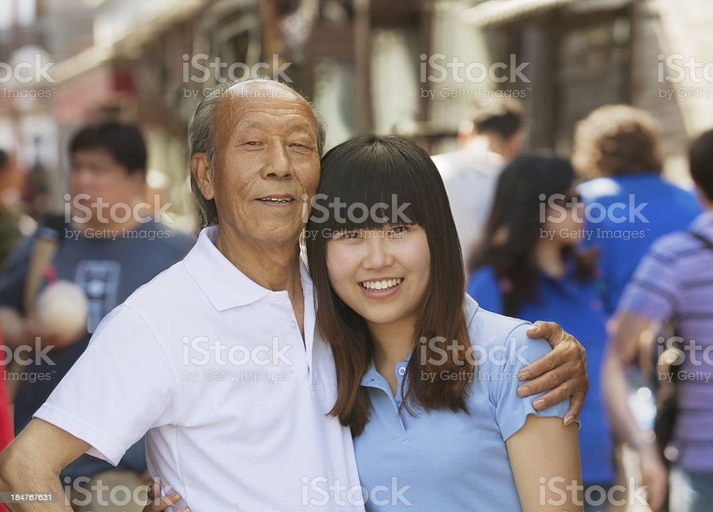 Portrait of grandfather and granddaughter together, outdoors in Beijing royalty-free stock photo