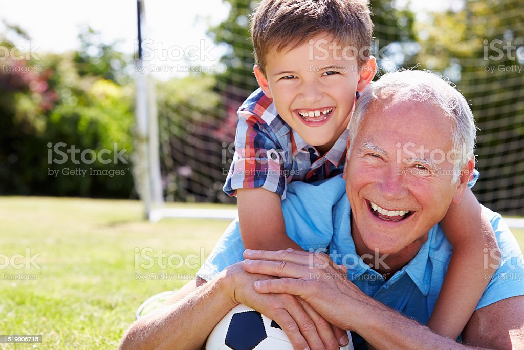 Portrait Of Grandfather And Grandson With Football stock photo