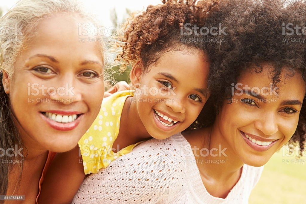 Portrait Of Grandmother With Daughter And Granddaughter stock photo
