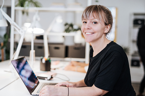 Coworkers working in modern co-working space in Scandinavia. Multi-ethnic group of young business professionals, start-up establishers, freelancers working and developing together.