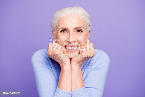 istock Portrait of gray haired happy beautiful old lady with beaming smile, healthy teeth, isolated over violet background 1042543872