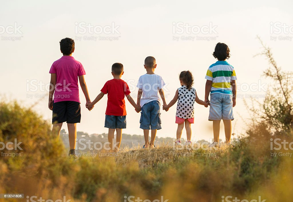 Portrait of group of children holding hands stock photo