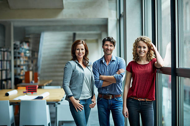 portrait of group of creative business people - three people stock photos and pictures