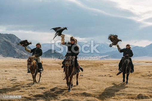 istock Portrait of group of eagle hunters near the river in Mongolia 1221845428