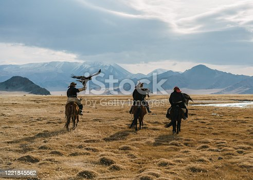 Portrait of group of eagle hunters in Mongolia  on the background of river
