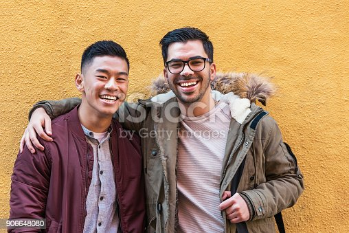 Portrait of group of friends looking the camera in the street. Friendship concept.
