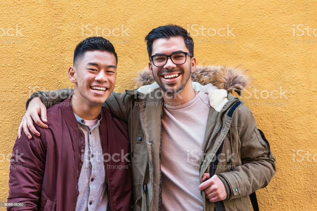 Portrait of group of friends looking the camera in the street. stock photo