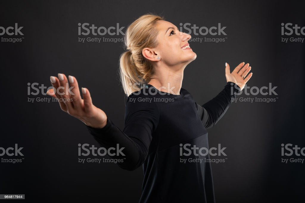Portrait of gym female trainer making winner gesture royalty-free stock photo