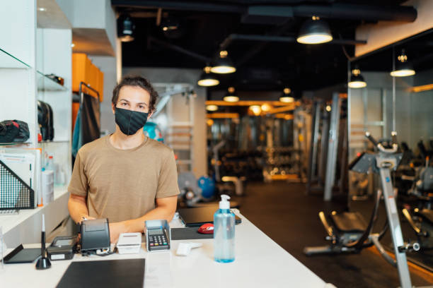 Portrait of gym owner while wearing protective face mask at entrance stock photo