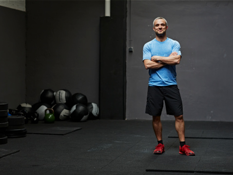 Portrait of gymer smiling at camera in gym