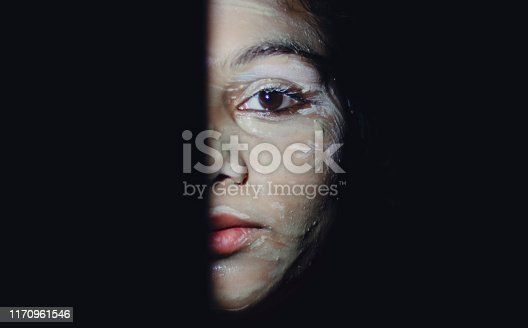 Indian teenager girl half face portrait, indoor shoot at home. shoot location at Delhi