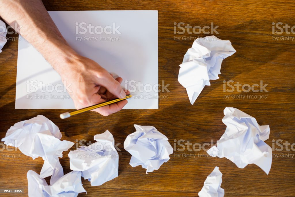 Portrait of hands drawing on a sheet of paper foto stock royalty-free