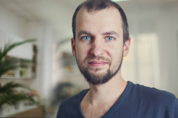 Portrait of handsome 35 year old man at home. Blured background. stock photo