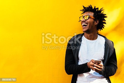 istock Portrait of handsome afro man using his mobile. 890698790