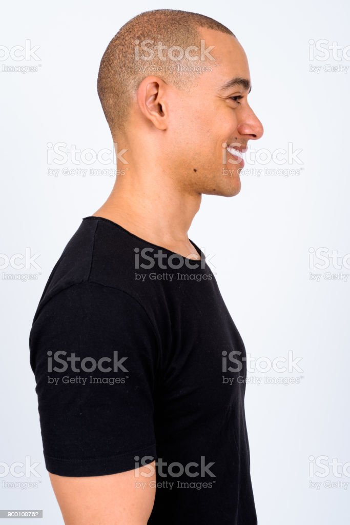 Portrait Of Handsome Bald Man Against White Background stock photo