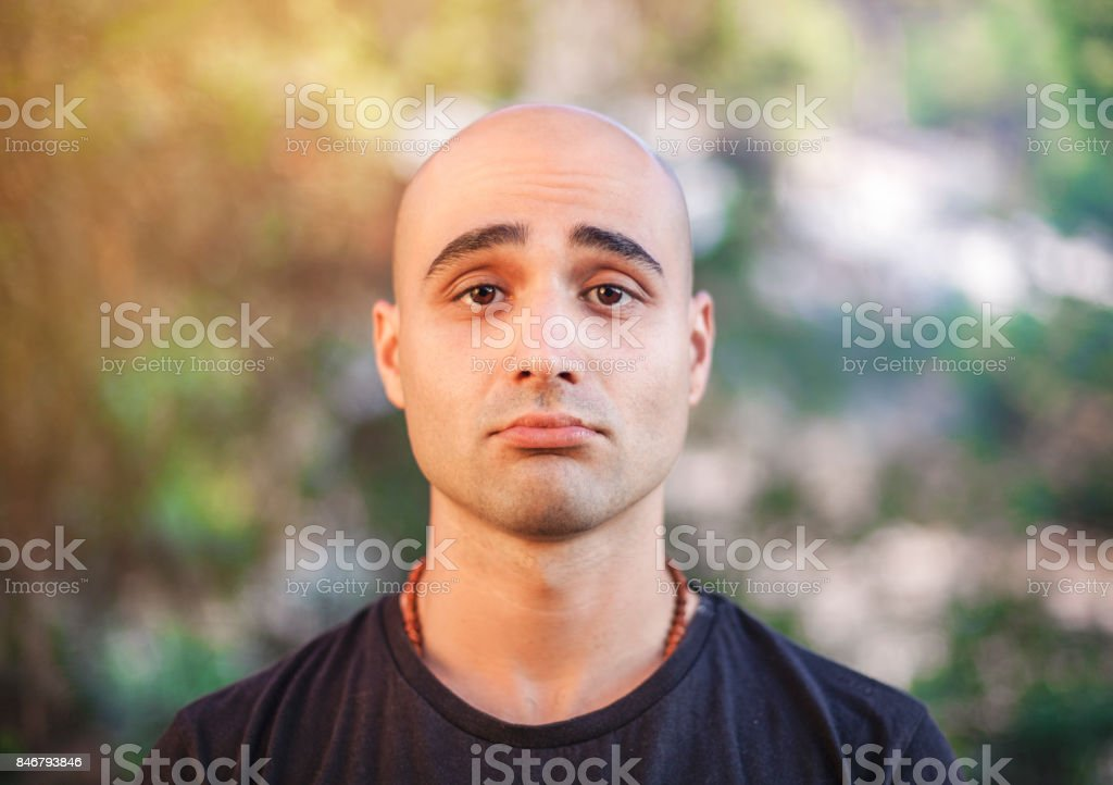 Portrait of Handsome bald young man outdoors stock photo