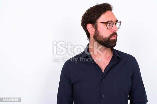 istock Portrait Of Handsome Bearded Man With Blue Eyes Against White Background 899699362