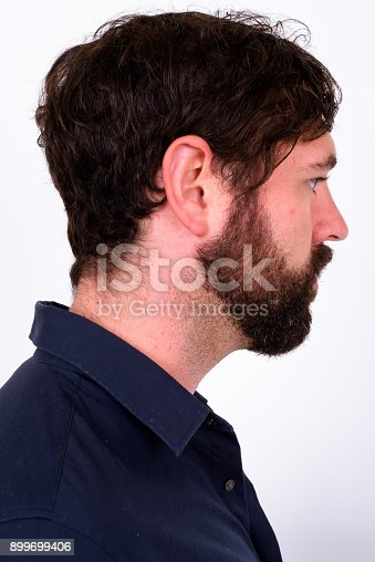 istock Portrait Of Handsome Bearded Man With Blue Eyes Against White Background 899699406