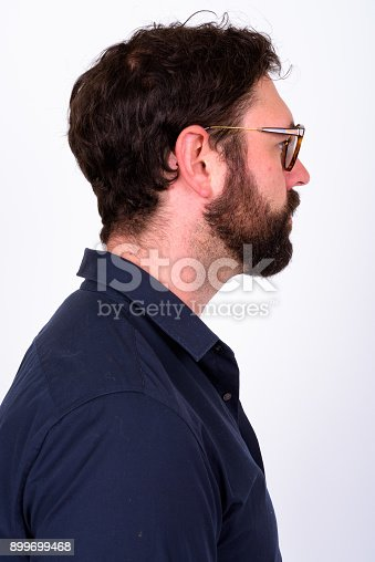 istock Portrait Of Handsome Bearded Man With Blue Eyes Against White Background 899699468