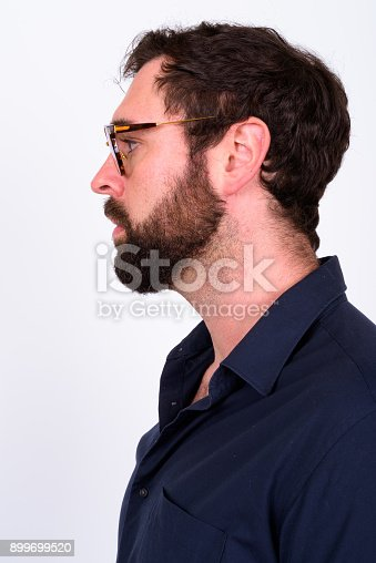 istock Portrait Of Handsome Bearded Man With Blue Eyes Against White Background 899699520
